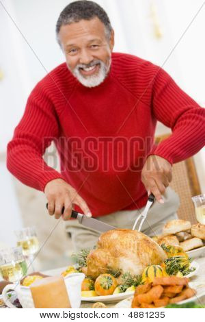 Man Carving Roast Chicken