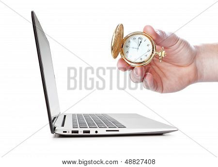 Time Control, The Hand Holding A Pocket Watch. The Side Of The Laptop.