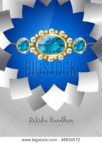 vector blue rakhi on stylish background