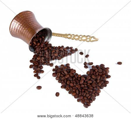 Coffee pot and coffee beans, isolated on white