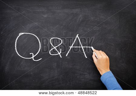 Questions and Answers - Q and A concept blackboard. Question and answer, support and help concept chalkboard concept with hand writing.