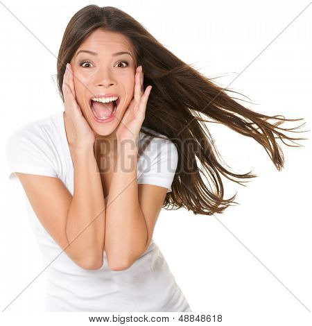 Surprised excited happy screaming woman isolated. Cheerful girl winner shocked over winning with funny joyful face expression. Multiracial Asian Chinese / Caucasian model isolated on white background.