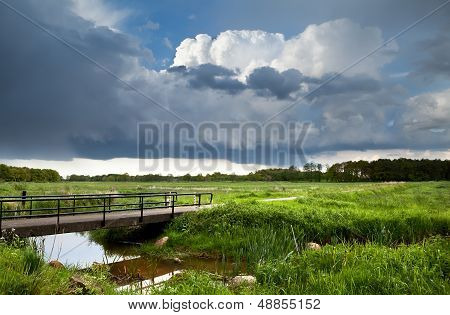 Bridge Over River And Stormy Clouds