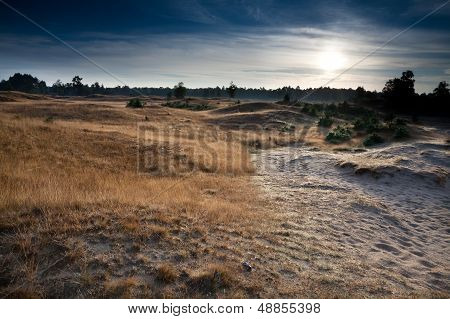 Sunrise Over Dunes And Hills