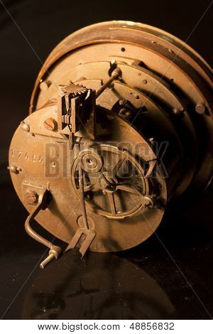 insides, including gears and cogs of an old clock, metaphor for teamwork