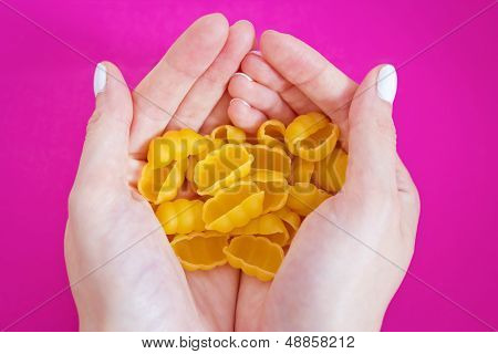 Woman's Hands Holding Italian Pasta, Close-up