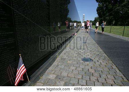 WASHINGTON, DC - JULY 29: An American flag is shown against the Vietnam Memorial on July 29, 2013 in Washington. The memorial honors U.S. service members who fought in the Vietnam War.