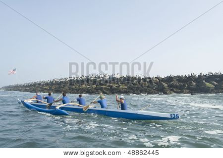 Multiethnic outrigger canoeing team heading to race stage