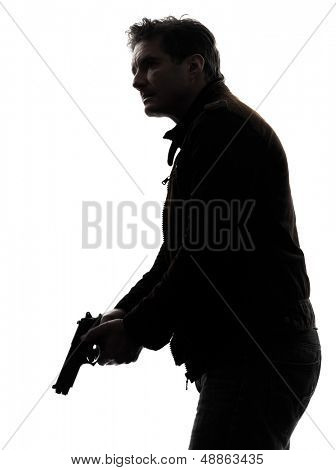 one man killer policeman holding gun silhouette studio white background