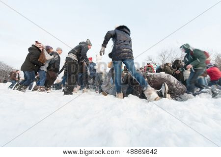 MOSCOW - DEC 9: A lot of people are having fun throwing snow at each other in Central Park of Culture and Rest named after Maxim Gorky December 9, 2012 Moscow, Russia. Park was established in 1928.