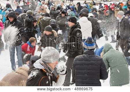 MOSCOW - DEC 9: A lot of people having fun throwing snow at each other in The Central Park of Culture and Rest named after Maxim Gorky on December 9, 2012, Moscow, Russia. Park was established in 1928
