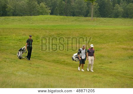 MOSCOW, RUSSIA - JULY 28: Mark Foster (left), Matthew Baldwin, both of England, and the caddie during final round of M2M Russian Open at Tseleevo Golf & Polo Club in Moscow, Russia on July 28, 2013