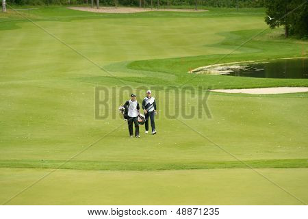 MOSCOW, RUSSIA - JULY 28: Soren Hansen of Denmark and his caddie during final round of the M2M Russian Open at Tseleevo Golf & Polo Club in Moscow, Russia on July 28, 2013