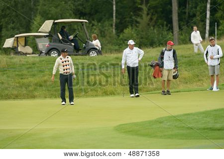 MOSCOW, RUSSIA - JULY 27: Mikko Korhonen of Finland (left), James Kingston of RSA (next) and caddies during 3rd day of M2M Russian Open at Tseleevo Golf & Polo Club in Moscow, Russia on July 27, 2013
