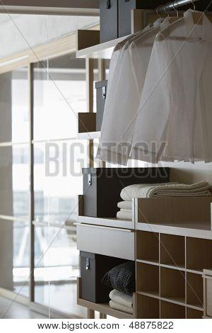 Shirts hanging in wardrobe at home
