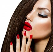 Sexy Beauty Girl with Red Lips and Nails. Makeup and Manicure. Beautiful Woman.  Provocative Make up