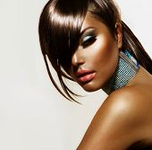 Fashion Beauty Girl. Gorgeous Woman Portrait. Stylish Haircut and Makeup. Hairstyle. Make up. Vogue