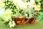 stock photo of jasmine  - Cup of tea with jasmine - JPG
