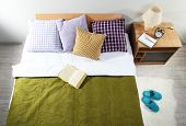 stock photo of floor covering  - Bed in room top view close - JPG