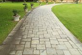 stock photo of paving stone  - the old stone walkway in the garden - JPG