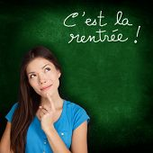 C'est la Rentree Scolaire - French college university student woman thinking Back to School written