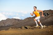 Running sport runner man sprinting in trail run. Fit male fitness sports athlete training sprint in