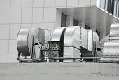 picture of blowers  - Industrial air conditioning and ventilation systems on a roof - JPG
