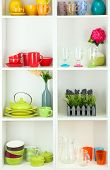 picture of armoire  - Beautiful white shelves with tableware and decor  - JPG