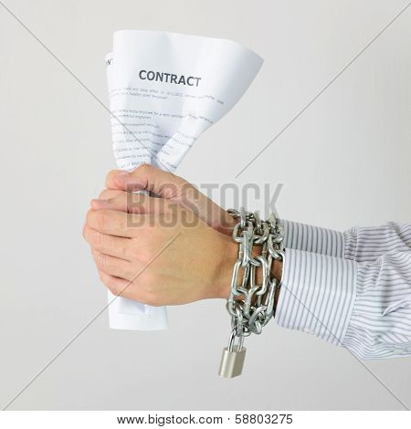 Businessman Hands With Chains And Contract