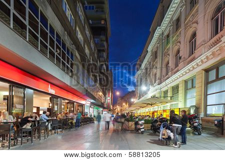 SARAJEVO, BOSNIA AND HERZEGOVINA - AUGUST 13, 2012: Street at night crowded with tourists - with motion blur.