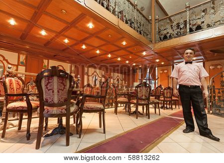 SARAJEVO, BOSNIA AND HERZEGOVINA - AUGUST 13, 2012: Owner of Wiener cafe poses in his restaurant, located in the centre of old town Sarajevo.