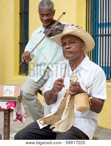 HAVANA,CUBA - JANUARY 15, 2014:Senior musicians playing traditional music.2 850 000 foreign tourists visited Cuba in 2013,many of them attracted by its distinct culture