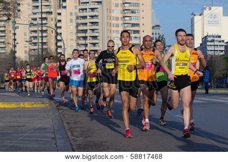 VALENCIA, SPAIN - JANUARY 12, 2014: Runners compete in the 10K Divina Pastora Valencia run. Over 10,500 people participated in the run.