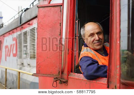 MOSCOW - MAY 23: locomotive driver on May 23, 2013 in Moscow, Russia. JSC Russian Railways in 2012 became one of the three largest transport companies in the world
