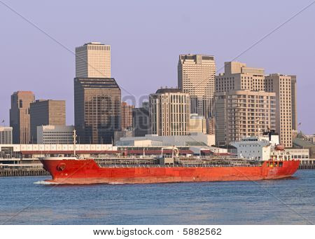 Cityscape: Cargo ship sail past New Orleans Skyline