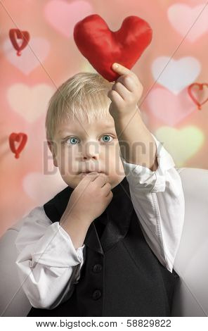 Little boy with red Heart in hands. Valentines Day concept.