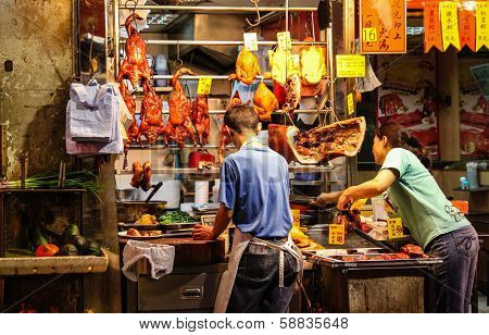 Sidewalk Vendors Selling Roasted Duck And Chicken In Hong Kong Street Market