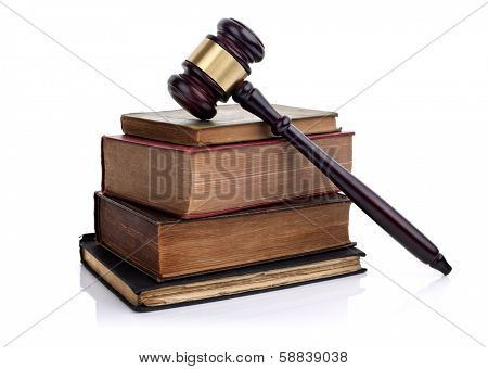 Judges wooden gavel on some old law books