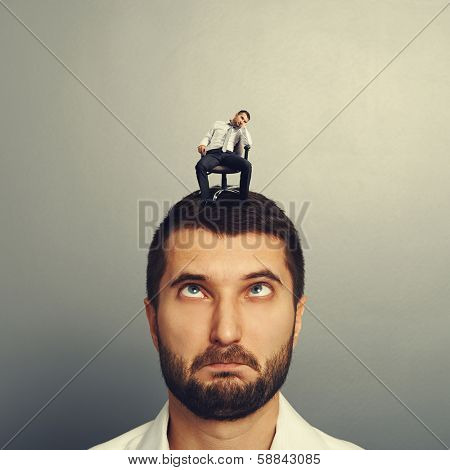 portrait of foolish man with small bored man on the head