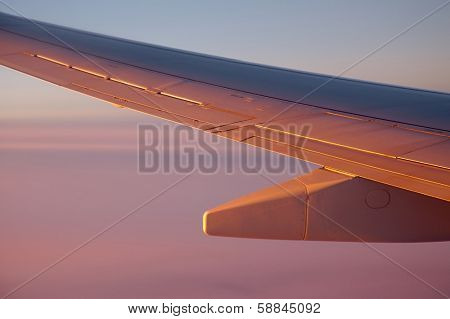 Sunrise view from an aircraft - Never forget to book a seat by the window