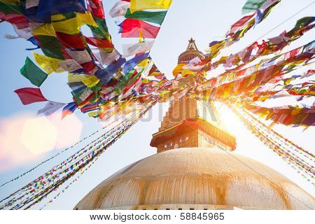 Bodhnath Stupa in Kathmandu with Buddha Eyes - shot against the sun.