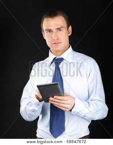 Businessman using computer plane-table