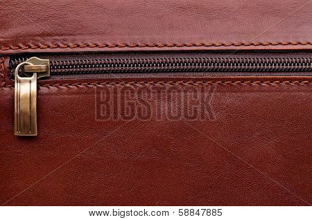 Closeup of brown leather briefcase with brass buckle