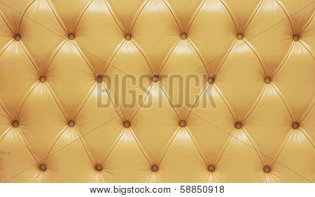 Biege genuine leather upholstery, closeup.