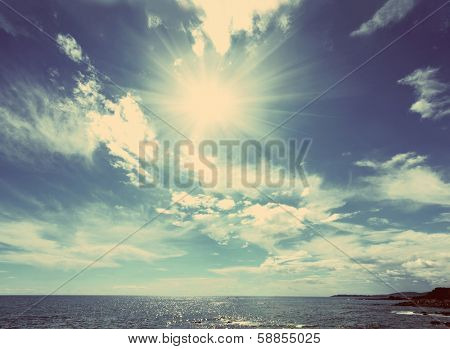 beautiful sea landscape with sun and clouds - vintage retro style