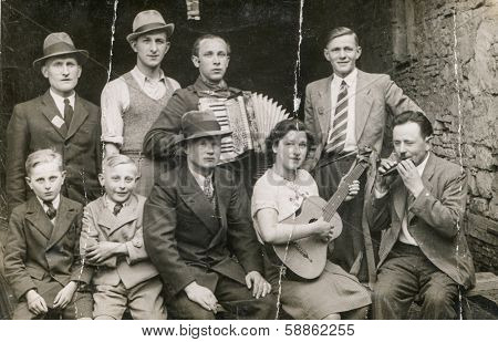 KREIS-BINGEN, GERMANY, CIRCA 1940s: Vintage photo of group of people with musical instruments