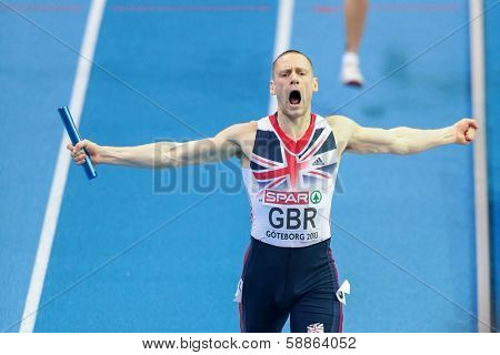 GOTHENBURG, SWEDEN - MARCH 3 Richard Stranan (Great Britain) and his team win the men's 4x400m relay finals during the European Athletics Indoor Championship on March 3, 2013 in Gothenburg, Sweden.