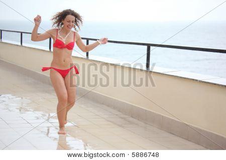 Beauty Girl Runs On Veranda Over Sea