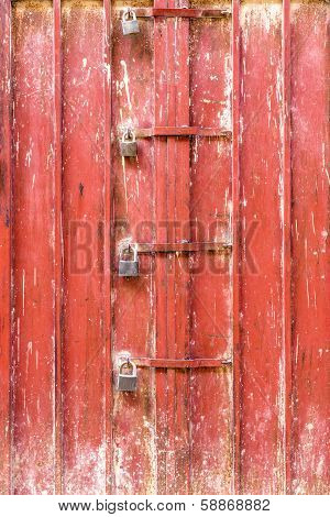 Four padlocks on a metal door