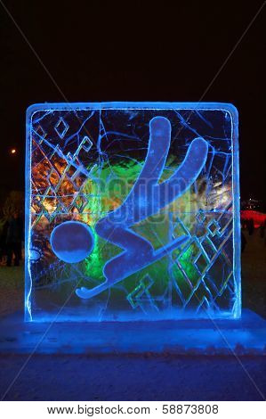 Perm, Russia - Jan 11, 2014: Illuminated Blue Toboggan Character Sculpture In Ice Town At Evening, C